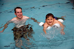 IMPACT participant and volunteer in pool