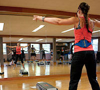 aerobics instructor teaching a class