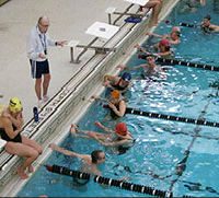Swimming instructor teaching students in the pool