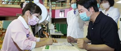 Taiwan's COVID-19 Vaccination Against Biological and Political Viruses